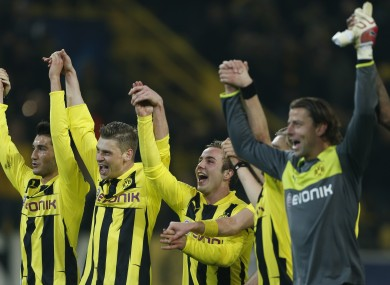 Dormund's teammates celebrate after winning the round of sixteen second leg Champions League soccer match.