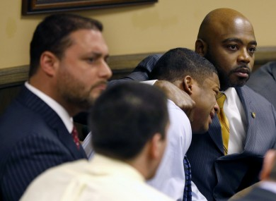 Ma'lik Richmond, second from right, is held by his lawyer as the judge finds him guilty in court on Sunday