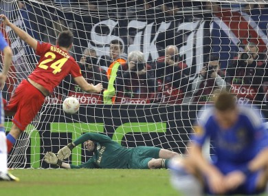 Fernando Torres can't watch as Raul Rusescu smashes home a penalty.