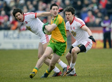 Tyrone's Sean Cavannagh with Matthew Donnelly and Donegal's Mark McHugh.