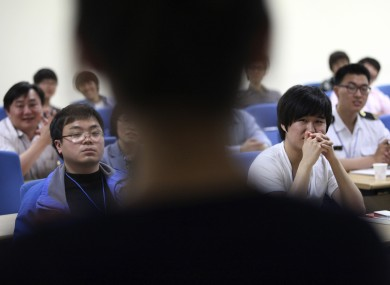 South Korean cyber activists listen to a lecture from a North Korean defector in Suwon, South Korea