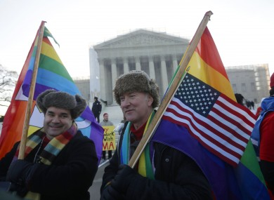 Marcus and Daniel German-Dominguez demonstrate outside the Supreme Court yesterday.