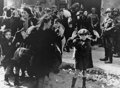 A group of Jewish people are moved from the Warsaw Ghetto by German soldiers on 19 April 1943