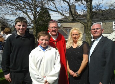 Edmond Roche (in white) with his family and the Bishop of CLoyne and Father Aquin Casey of Fermoy
