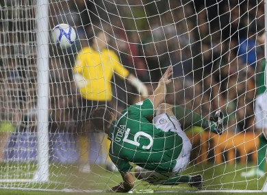 Darren O'Dea gets tangled in the net after Germany score against Ireland.