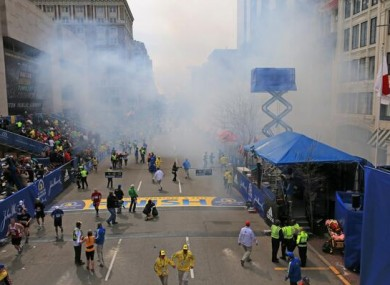 Boston Globe photographer David L Ryan captured the immediate aftermath of the blasts at Boylston Street in central Boston.