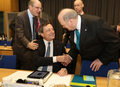 Michael Noonan greets ECB president Mario Draghi ahead of this morning's Eurogroup meeting at Dublin Castle.