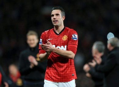 Manchester United's Robin Van Persie celebrates winning the title on the pitch after the final whistle.