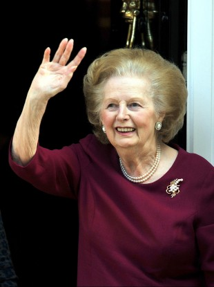 Margaret Thatcher waves to wellwishers from her home in London in 2010 after being hospitalised for flu.