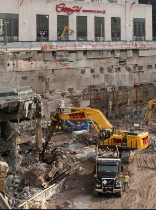 Construction workers and equipment excavate the World Trade Center site in 2008. The latest search through 9/11 debris will include materials taken from parts of the WTC site which could not previously been accessed.