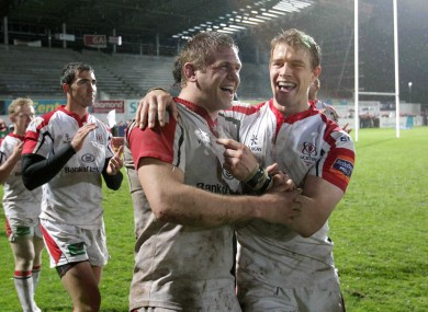 Ulster's Chris Henry and Andrew Trimble celebrate after beating Cardiff.