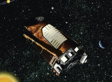 This artist rendition provided by NASA shows the Kepler space telescope. The spacecraft lost the second of four wheels that control the telescope's orientation in space.