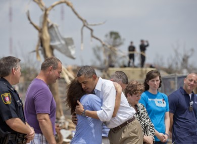 President Obama embraces a school official as he views the devastation of the Plaza Towers Elementary School in Oklahoma.