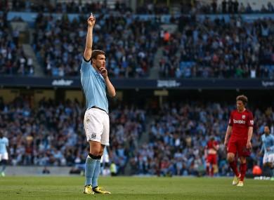 Dzeko celebrates the game's only goal.