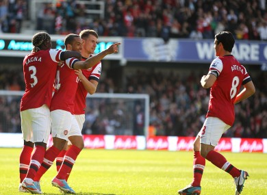 Arsenal's Theo Walcott (second left) celebrates with his team-mates Aaron Ramsey (second right), Bacary Sagna (left) and Mikel Arteta (right).