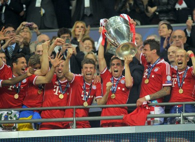 Phillipp Lahm lifts the trophy.