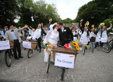 Bride and Groom Alfreda O'Brien and Ciaran Kavanagh take part in the 20th Annual Bloomsday Messenger Bike Rally in Dublin .