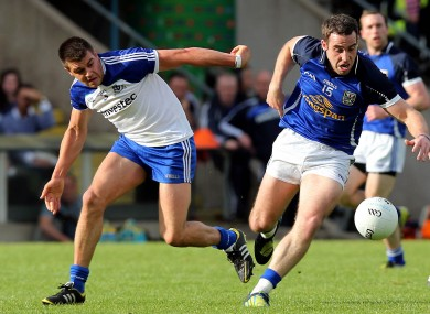 Cavan's Eugene Keating with Drew Wylie of Monaghan.