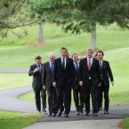 Here come the boys... European Commission president Jose Manuel Barroso, President of the European Council Herman Van Rompuy, Prime Minister David Cameron, Dmitry Medvedev of Russia, Stephen Harper of Canada and Naoto Kan of Japan on their way to a family photograph at the G8 Summit in Muskoka, Canada in 2010. (Image: Stefan Rousseau/PA Wire)