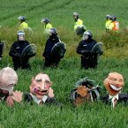 Effigies of the leaders of the G8 stand in a field near Gleneagles following scuffles between police in riot gear and protest groups. (Image: John Giles/PA Archive/Press Association Images)