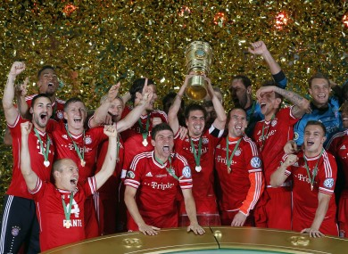 Bayern's players celebrate with the trophy during the winning ceremony for the German Soccer Cup Final.