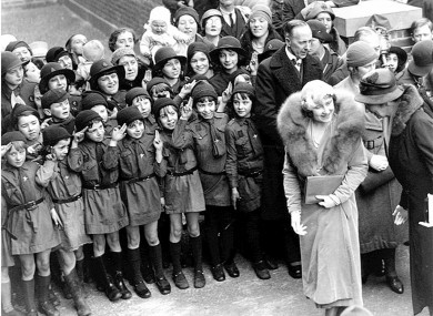 Girl Guides salute the former Queen Mother in the east end of London in 1933