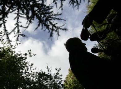 A silhouette of Enda Kenny is seen at the launch of a National Trails Day in 2011.