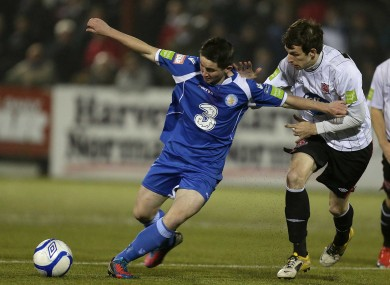 Dundalk's Paul Whelan (right) with Sean Maguire of Waterford United.