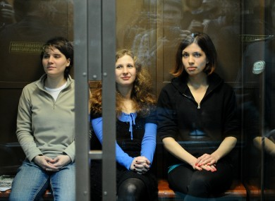 Yekaterina Samutsevich, Maria Alyokhina, Nadezhda Tolokonnikova (L-R)