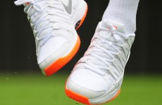 Snooty Wimbledon officials scold 7-time champ Federer over orange soles