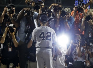 American League's Mariano Rivera, of the New York Yankees, poses for photographers after the MLB All-Star baseball game last night.