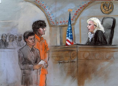 This courtroom sketch depicts Boston Marathon bombing suspect Dzhokhar Tsarnaev standing with his lawyer Miriam Conrad.