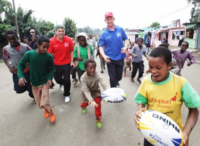 Ian Madigan and Leo Cullen with some Ethiopian children is Adiis Ababa.