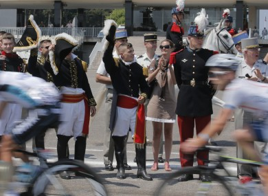 Cadets of the Special Military School of Saint-Cyr salute the peloton as it passes.