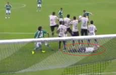 Brazilian player tries to stop low free-kick — by lying down behind the wall