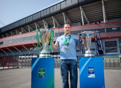 Pictured with the Heineken Cup and the Amlin Challenge Cup at the Millennium Stadium is Gethin Jenkins of the Cardiff Blues, a previous winner of both trophies.