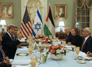 US diplomat John Kerry (left) with Palestinian and Israeli negotiators at dinner last night