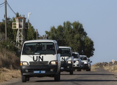 UN vehicles drive into a UN base near the Quneitra crossing between the Israeli-controlled Golan Heights and Syria.