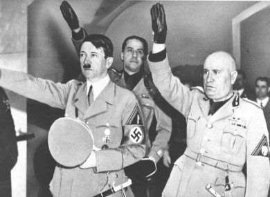Adolf Hitler, left, and Benito Mussolini saluting during a 1938 meeting.