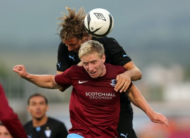 Paul O'Connor of Drogheda with Markus Halsti of Malmo.