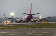 Eight injured as plane lands nose-first in New York
