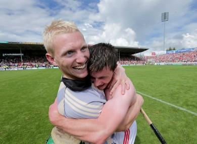 Cork's Stephen White and Daniel Kearney celebrate the final whistle.