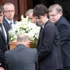 The coffin carrying the remains of RTÉ Sports presenter Colm Murray is removed from St Gabriel's Church.<span class=