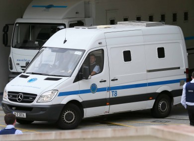 The prison van believed to be carrying John Dundon arrives at the Criminal Courts of Justice.