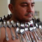 This man holds the record for 'most spoons on human body', seen here with 50 magnetised to his body... (AP Photo/Shakh Aivazov).