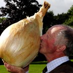 Peter Glazebrook from Newark  holds the record for the heaviest onion at 18lbs 1oz (John Giles/PA Wire).