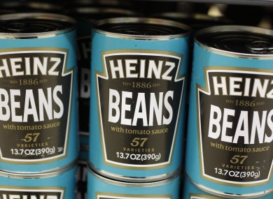 Heinz Beans on the supermarket shelf.