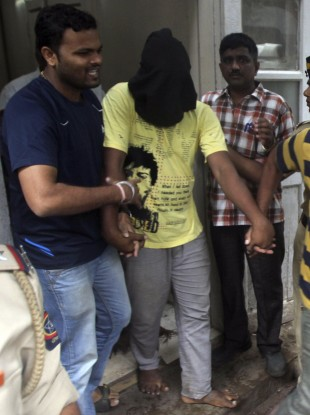 Police officials escort the fifth man accused of the gang rape in Mumbai earlier today.