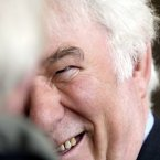Heaney during a ceremony to mark his election of Mr Friel as Saoi in Aosdana in 2006<span class=