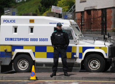 A PSNI vehicle and officer (File photo)